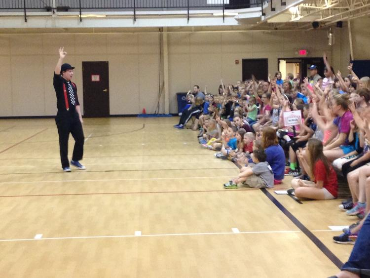 Mazing Matthias performing at a school assembly